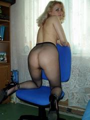 Russian wife in pantyhose spreads at home