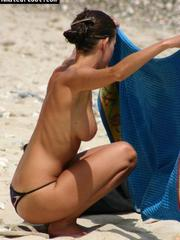 Spy pics of busty gf topless at the beach