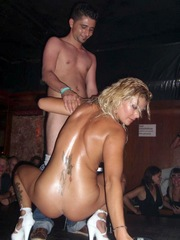 Shaved blonde stripper with small breasts