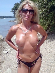 Mature wife with silicone breasts poses..