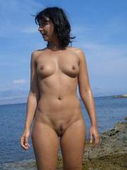 Nudist wife with firm breasts naked..