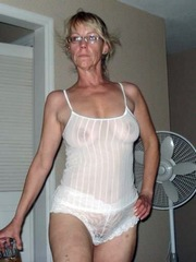 Horny wife poses around the house in..