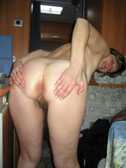 Mature hairy pussy woman spreading her..